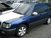 Subaru Forester - тонирование стоп сигналов и отличное сочетание белого цвета поклеенных дисков капота и крыши с родной синей краской.